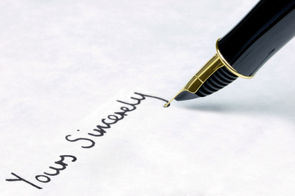 Yours Sincerely written on paper using a gold fountain pen.